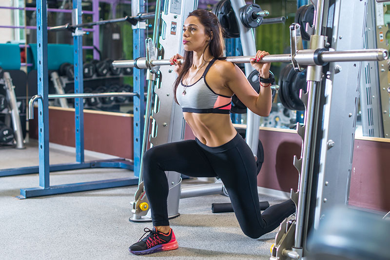 Woman Doing Lunges at the Gym