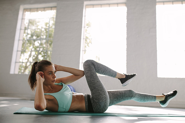 Woman doing crunches to get tight toned abs and core